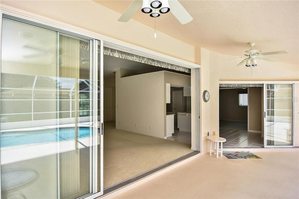 Lanai to great room and dinette/kitchen - Single Family Home for sale at 2232 E Village Cir, Venice, FL 34293 - MLS Number is N6105697