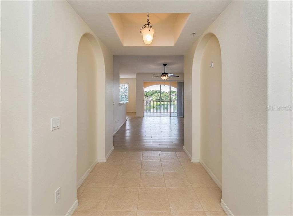 Foyer to living room - Condo for sale at 1761 Auburn Lakes Dr #22, Venice, FL 34292 - MLS Number is N6106204