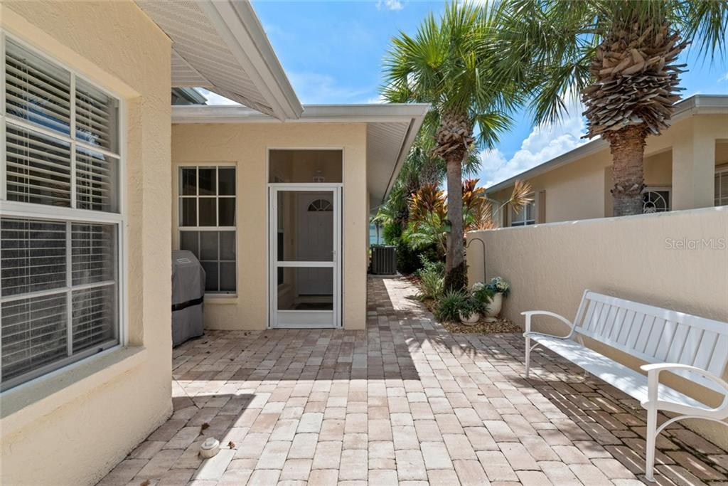 Entry - Villa for sale at 1708 Fountain View Cir, Venice, FL 34292 - MLS Number is N6106422