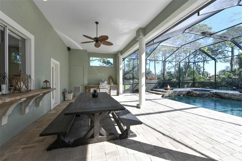 Lanai to outdoor kitchen and pool - Single Family Home for sale at 854 Macewen Dr, Osprey, FL 34229 - MLS Number is N6106697