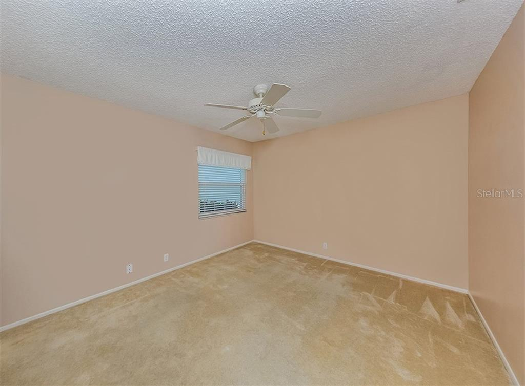 Bedroom 2 - Single Family Home for sale at 4822 Limetree Ln, Venice, FL 34293 - MLS Number is N6106780