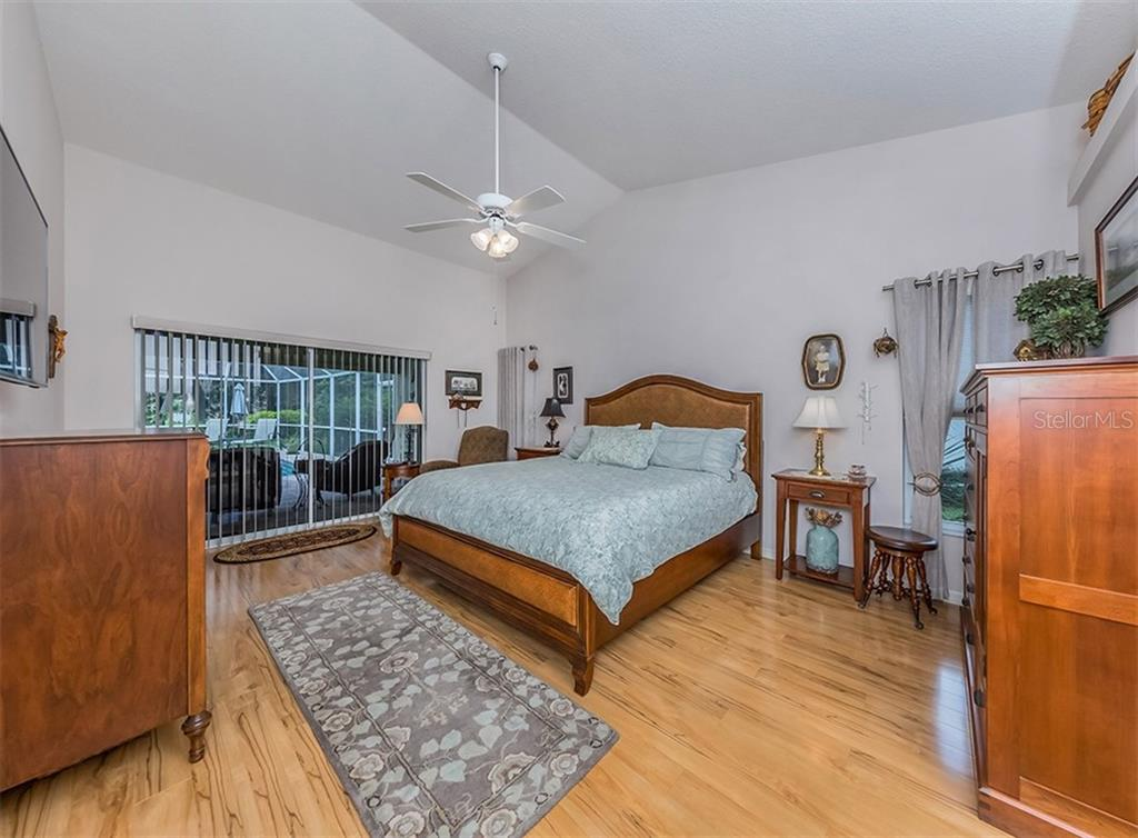 Master bedroom with slider to lanai - Single Family Home for sale at 521 Waterwood Ln, Venice, FL 34293 - MLS Number is N6107048