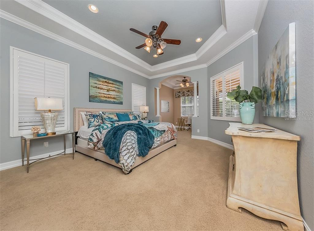 Master bedroom. Virtually Staged - Single Family Home for sale at 262 Pesaro Dr, North Venice, FL 34275 - MLS Number is N6107589