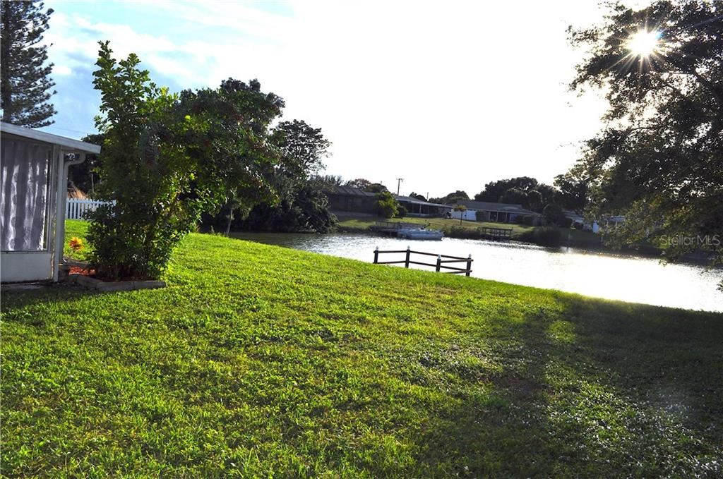 View of the backyard and your own private dock. Plenty of room to build a pool, and no HOA so you can have a fence! - Single Family Home for sale at 1656 La Gorce Dr, Venice, FL 34293 - MLS Number is N6107911