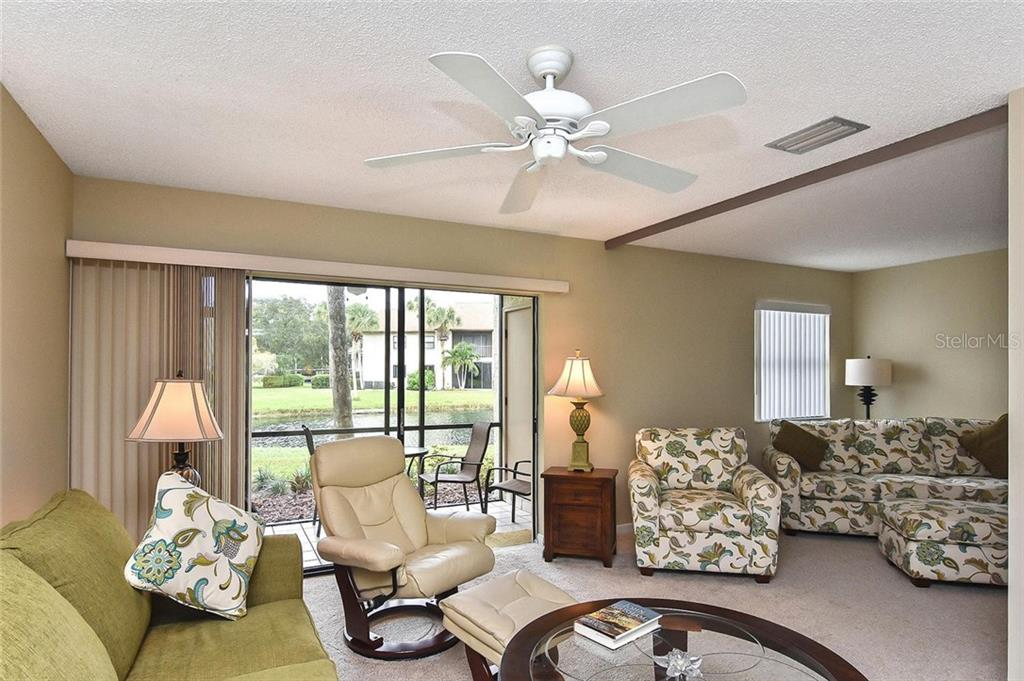Living room to 2nd bedroom - Condo for sale at 626 Bird Bay Dr S #104, Venice, FL 34285 - MLS Number is N6107935