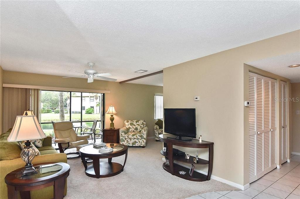 Living room - Condo for sale at 626 Bird Bay Dr S #104, Venice, FL 34285 - MLS Number is N6107935