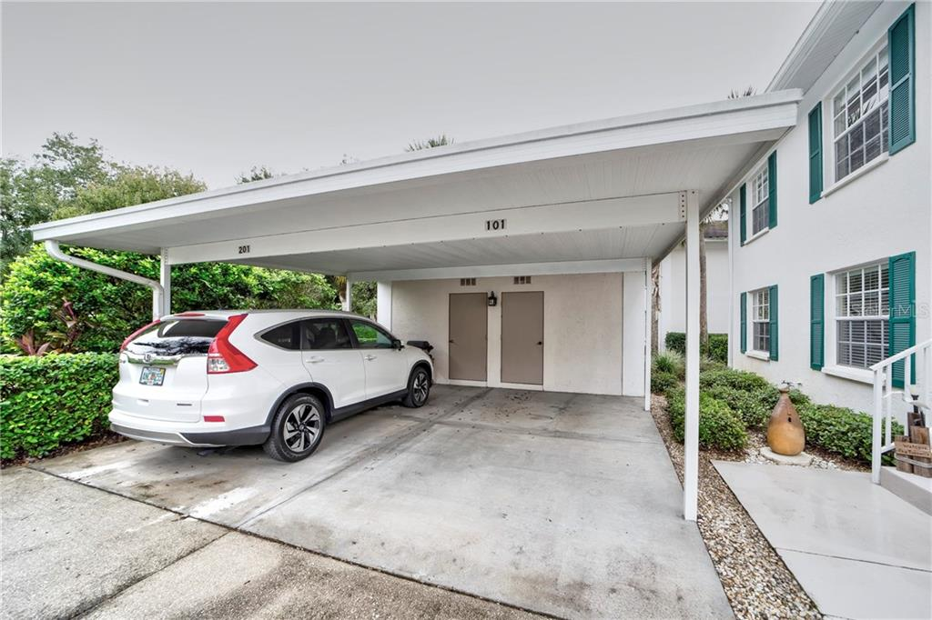 Carport with Attached Storage Unit - Condo for sale at 815 Montrose Dr #101, Venice, FL 34293 - MLS Number is N6107969