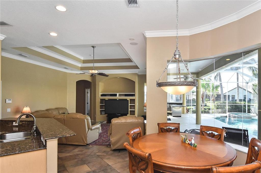 Dinette to family room - Single Family Home for sale at 321 Dulmer Dr, Nokomis, FL 34275 - MLS Number is N6108685