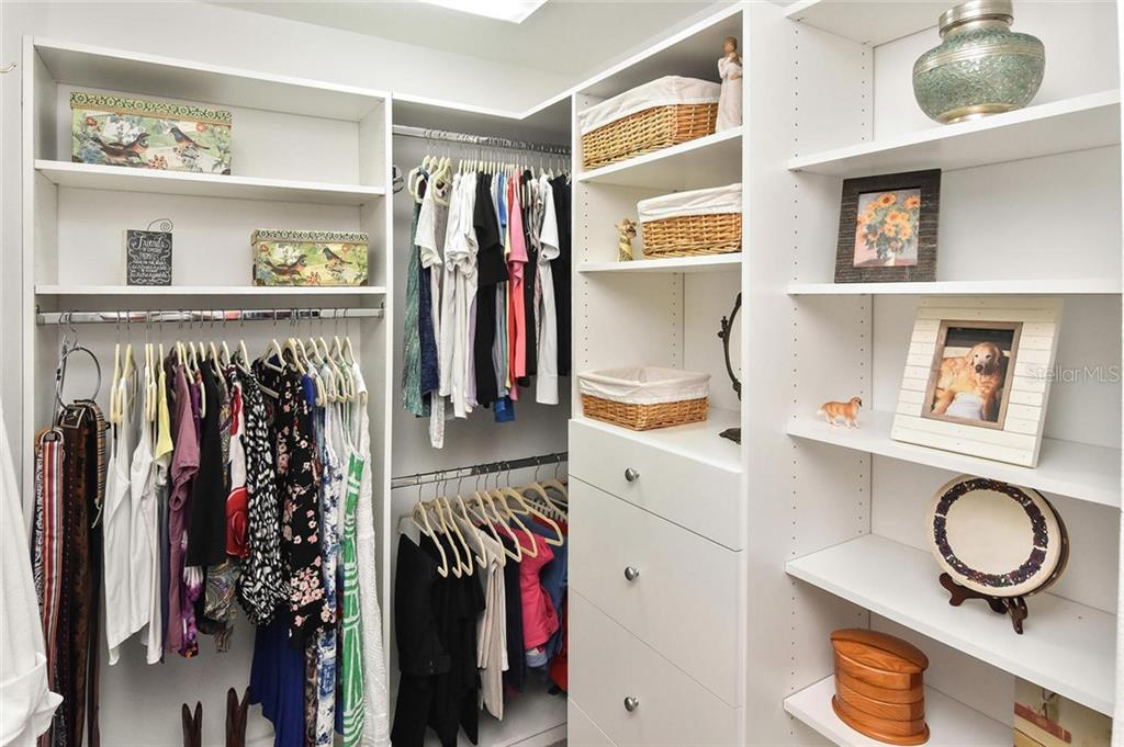 Master closet with magnificent organizers - Single Family Home for sale at 7185 N Serenoa Dr, Sarasota, FL 34241 - MLS Number is N6109058