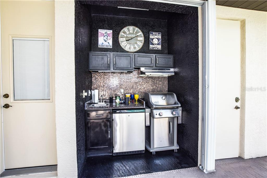 Summer Kitchen. - Single Family Home for sale at 2560 Pebble Creek Pl, Port Charlotte, FL 33948 - MLS Number is N6109100