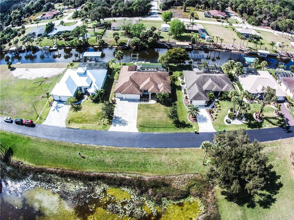 Aerial of home looking at canal. - Single Family Home for sale at 2560 Pebble Creek Pl, Port Charlotte, FL 33948 - MLS Number is N6109100