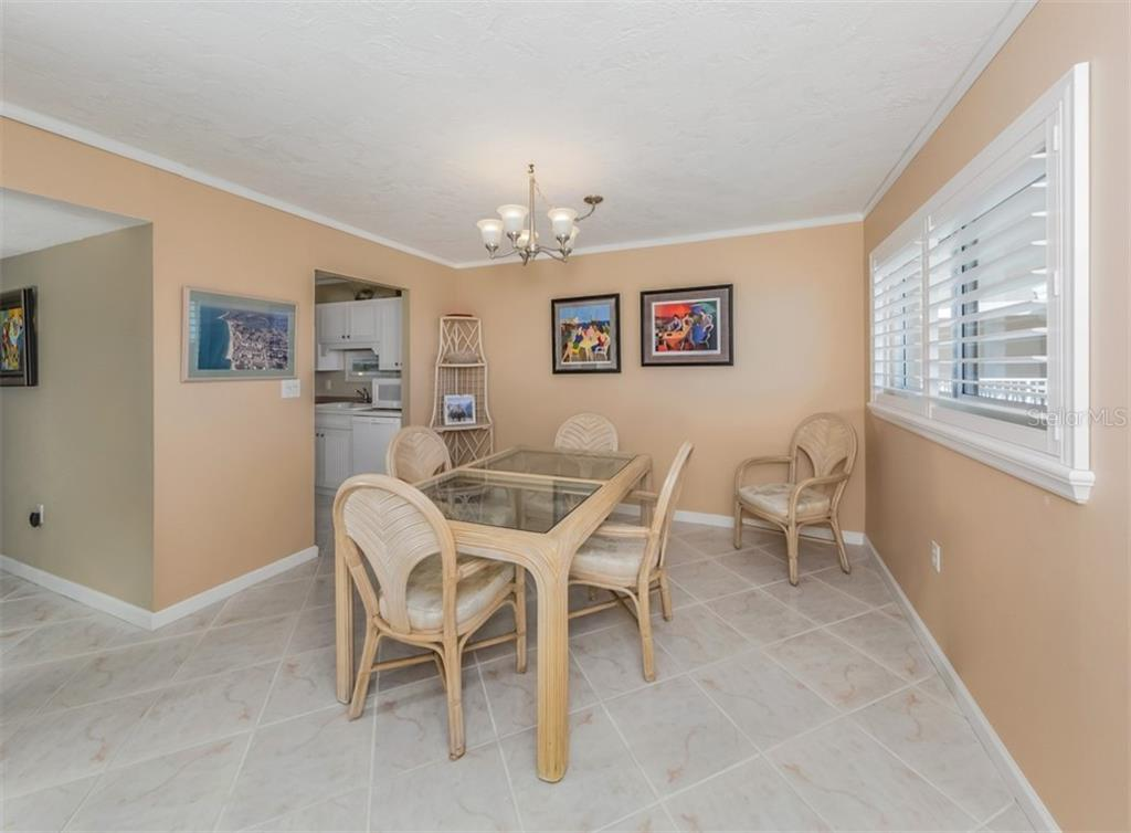 Dining area upon entry - Condo for sale at 555 The Esplanade N #1004, Venice, FL 34285 - MLS Number is N6109326