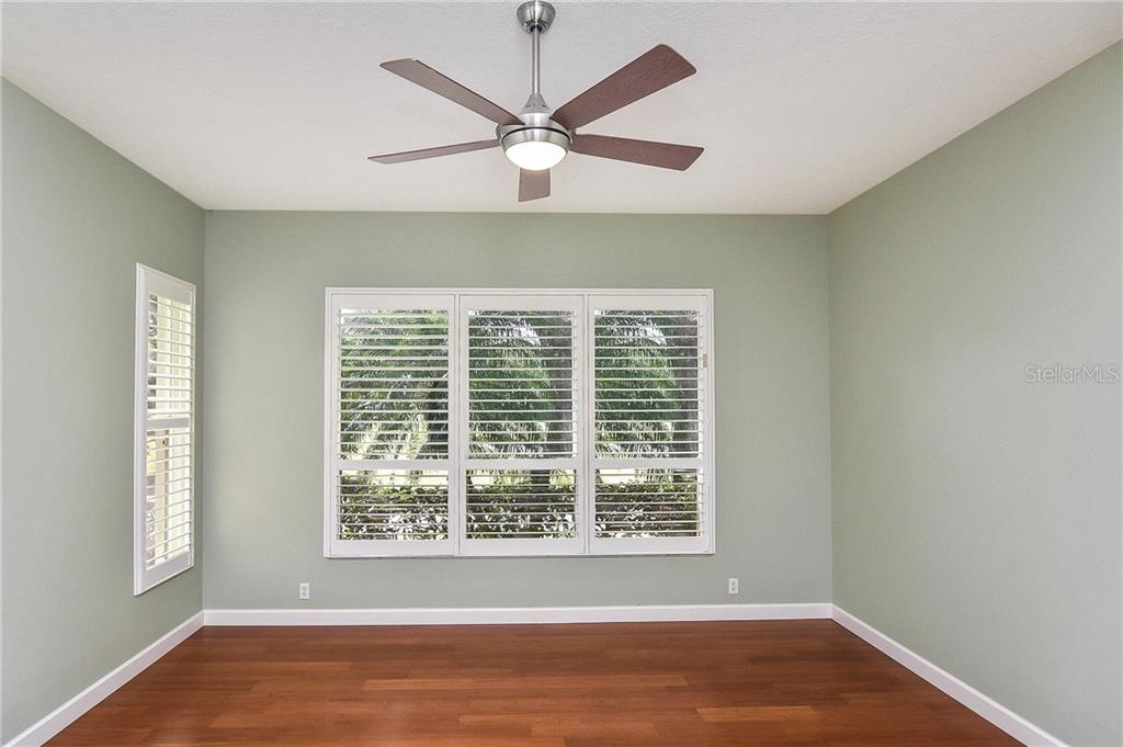 Spacious master bedroom with plantation shutters and new bamboo floors - Single Family Home for sale at 323 Lansbrook Dr, Venice, FL 34292 - MLS Number is N6109725