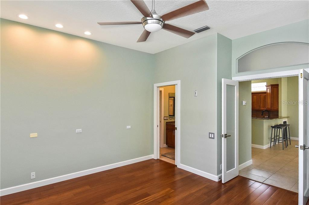 3rd bedroom/den with bamboo floors and new french doors - Single Family Home for sale at 323 Lansbrook Dr, Venice, FL 34292 - MLS Number is N6109725