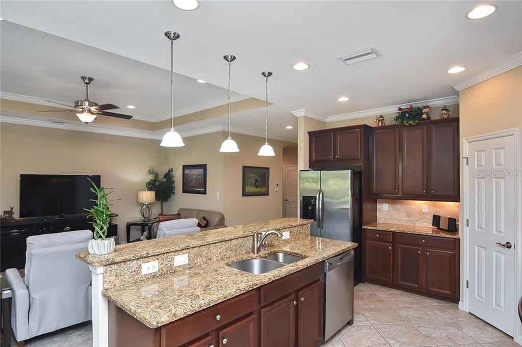 Kitchen to great room - Single Family Home for sale at 5093 Layton Dr, Venice, FL 34293 - MLS Number is N6109788