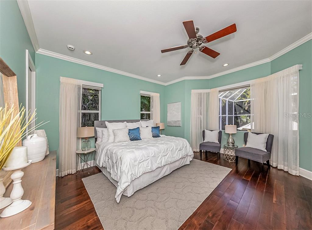 Master bedroom with warm wood floors. - Single Family Home for sale at 727 Eagle Point Dr, Venice, FL 34285 - MLS Number is N6110087
