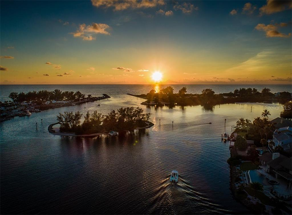 Sunset view heading out the inlets just minutes from your dock. - Single Family Home for sale at 727 Eagle Point Dr, Venice, FL 34285 - MLS Number is N6110087