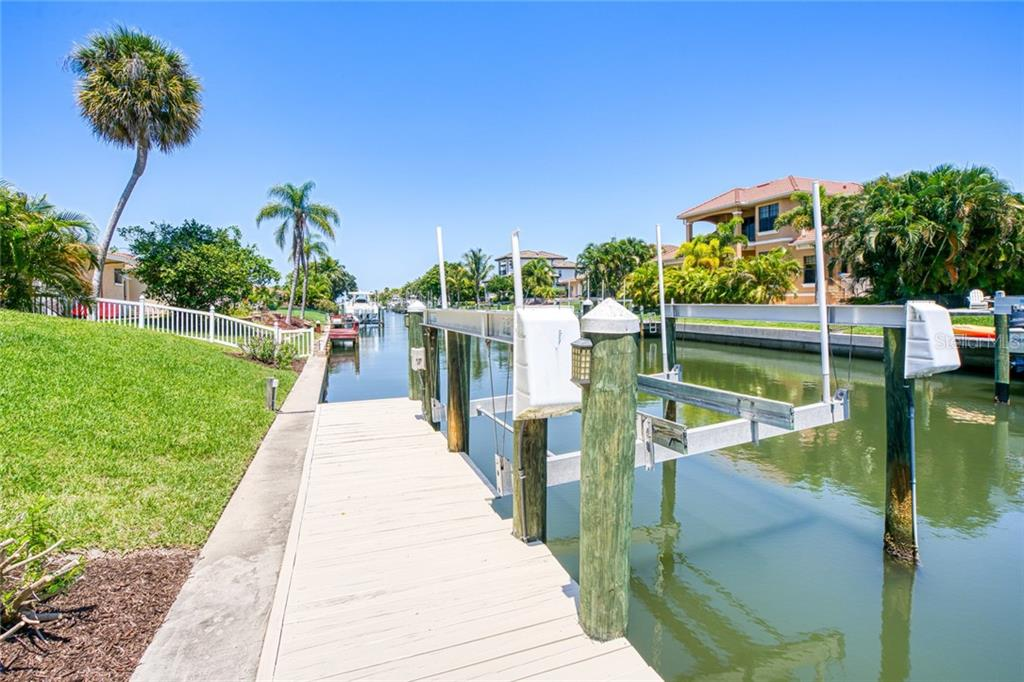 View of Canal and dock lift - Single Family Home for sale at 510 Bowsprit Ln, Longboat Key, FL 34228 - MLS Number is N6110334