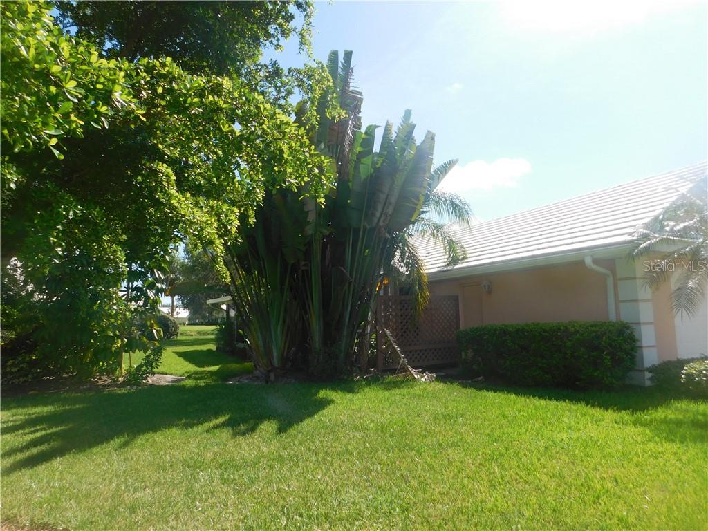 Side view of home - Villa for sale at 743 Harrington Lake Dr N #29, Venice, FL 34293 - MLS Number is N6111290