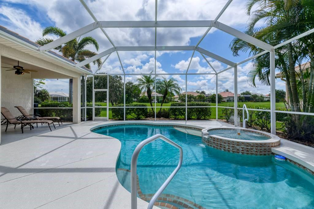 Heated pool and spa - Single Family Home for sale at 601 Cockatoo Cir, Venice, FL 34285 - MLS Number is N6111658