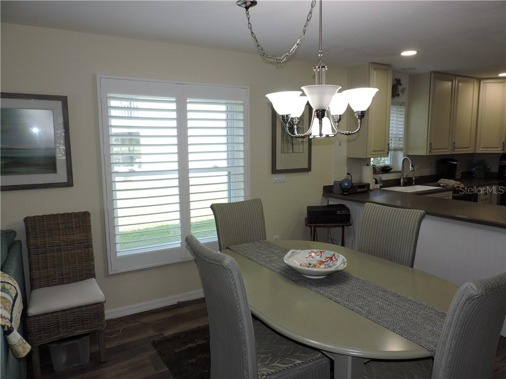 Dining Area with new Hurricane Window and Plantation shutter - Condo for sale at 1041 Capri Isles Blvd #121, Venice, FL 34292 - MLS Number is N6112042
