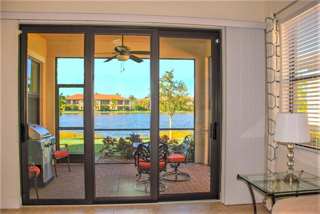 Great room - Single Family Home for sale at 10424 Crooked Creek Dr, Venice, FL 34293 - MLS Number is N6112285