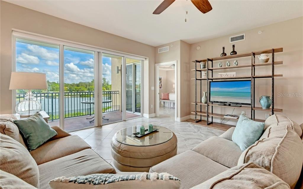 Living room, ICW, balcony - Condo for sale at 167 Tampa Ave E #313, Venice, FL 34285 - MLS Number is N6112536