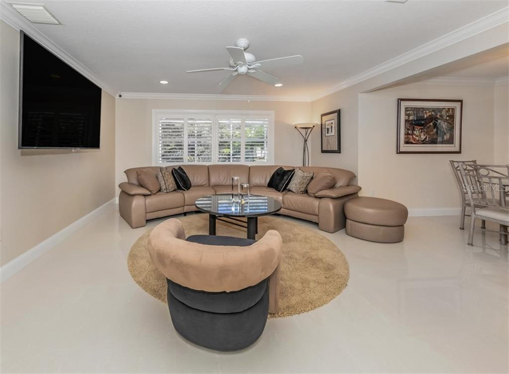 Family room - Single Family Home for sale at 1321 Guilford Dr, Venice, FL 34292 - MLS Number is N6113272
