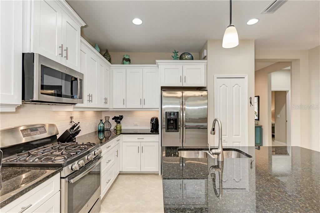 Kitchen - Villa for sale at 11433 Okaloosa Dr, Venice, FL 34293 - MLS Number is N6113314