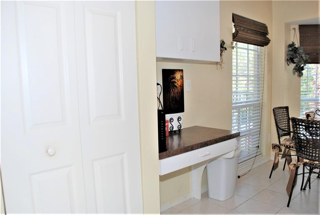 Kitchen pantry and desk - Condo for sale at 406 Laurel Lake Dr #203, Venice, FL 34292 - MLS Number is N6113915