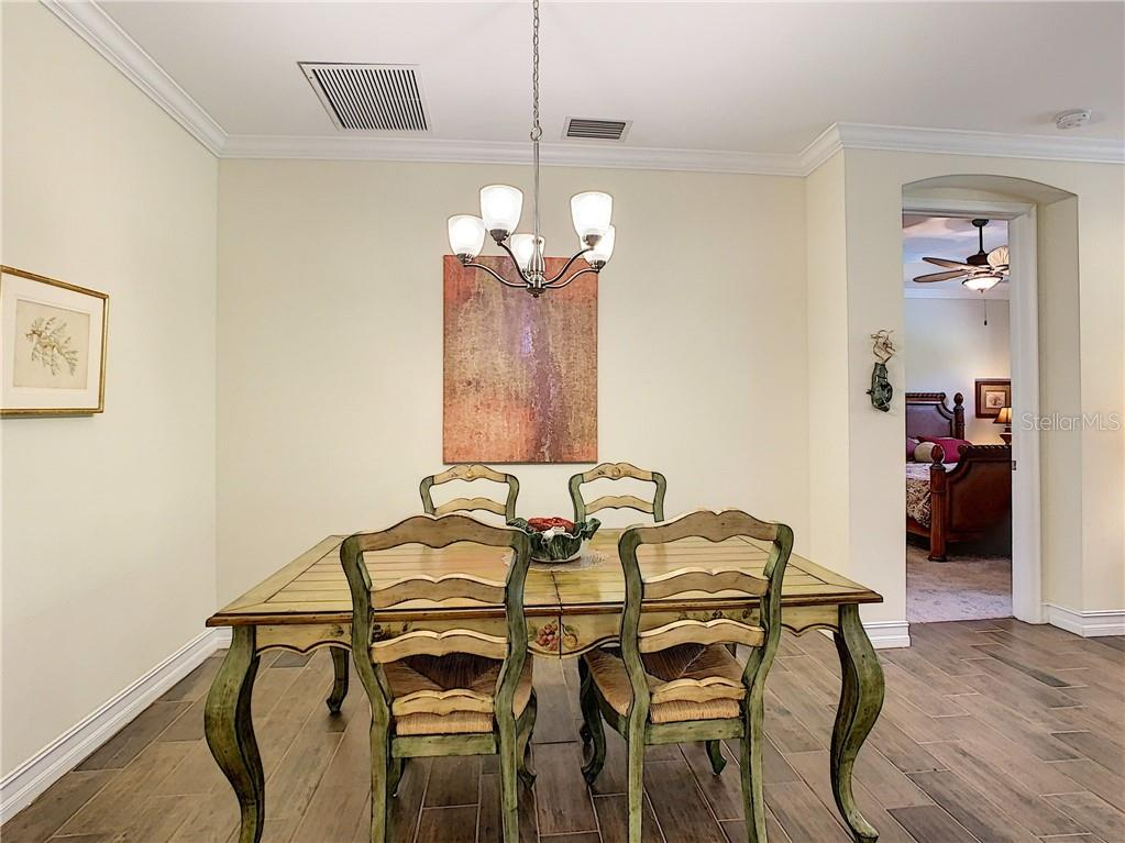 Dining area - Single Family Home for sale at 108 Maraviya Blvd, North Venice, FL 34275 - MLS Number is N6113946