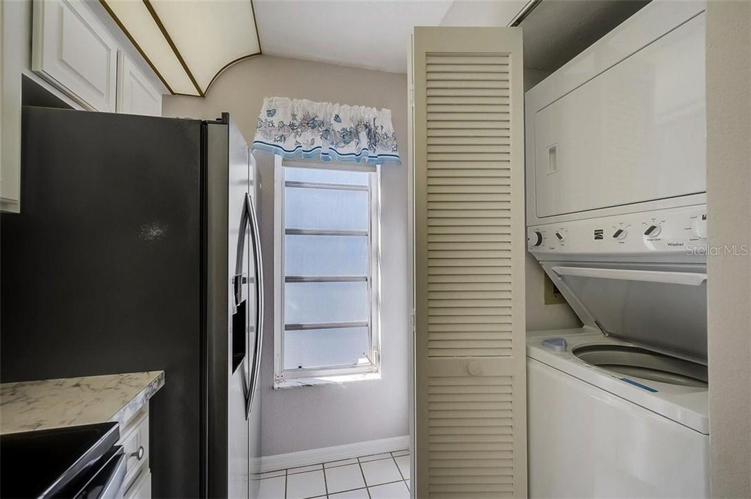 Laundry closet - Condo for sale at 1041 Capri Isles Blvd #105, Venice, FL 34292 - MLS Number is N6114557