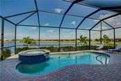 Heated Salt Water Pool and Spa with stunning lake view. - Single Family Home for sale at 23692 Waverly Cir, Venice, FL 34293 - MLS Number is N5912967