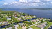 Gulf of Mexico Just beyond the Myakka River only seconds from your backyard dock. Right at your doorstep is  excellent boating, fishing and water sports. Custom Home with Many Extras and Upgrades. Pride of Ownership and Quality exudes from every thoughtful aspect and Every Custom Detail. You can see the Myakka River from the new 2 level Composite Dock that has Water and Electric at both ends. Two (2) Remote Lifts a 10,000 LB boat Lift and a Swing Lift for Canoes or Kayaks or Wave Runners - Single Family Home for sale at 5149 Latham Ter, Port Charlotte, FL 33981 - MLS Number is N5914515