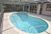 Pool to Florida room - Single Family Home for sale at 1410 Strada D Argento, Venice, FL 34292 - MLS Number is N5914540