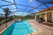 View from the dining room to the pool. - Single Family Home for sale at 190 Portofino Dr, North Venice, FL 34275 - MLS Number is N5915077