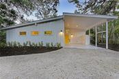 Front Elevation at dusk. - Single Family Home for sale at 4533 Banan Pl, Sarasota, FL 34242 - MLS Number is N5915472
