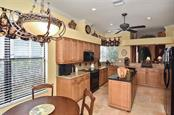 Dinette/kitchen - Single Family Home for sale at 769 Sawgrass Bridge Rd, Venice, FL 34292 - MLS Number is N5916484