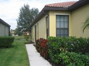 Side entry with screend in porch area - Villa for sale at 1445 Maseno Dr, Venice, FL 34292 - MLS Number is N5916837