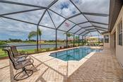 Generous screened enclosure with custom pool & pavers - Single Family Home for sale at 20145 Cristoforo Pl, Venice, FL 34293 - MLS Number is N6100537