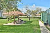 Picnic area - Condo for sale at 654 Bird Bay Dr E #201, Venice, FL 34285 - MLS Number is N6101101