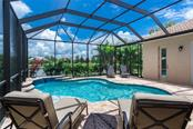 Pool with lakefront view - Single Family Home for sale at 368 Marsh Creek Rd, Venice, FL 34292 - MLS Number is N6101204