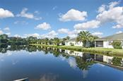 Lake view - Villa for sale at 1720 Fountain View Cir, Venice, FL 34292 - MLS Number is N6101363