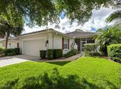 Front walkway to entry - Villa for sale at 865 Tartan Dr, Venice, FL 34293 - MLS Number is N6101901