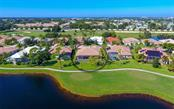 Rear aerial from lake - Single Family Home for sale at 979 Chickadee Dr, Venice, FL 34285 - MLS Number is N6102266