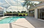 Screened lanai, pool, under 2 roofs - Single Family Home for sale at 969 Chickadee Dr, Venice, FL 34285 - MLS Number is N6102722