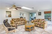 huge family room, has a sky light, tile floors, sliding glass door to covered screen lanai. - Single Family Home for sale at 3656 Clematis Rd, Venice, FL 34293 - MLS Number is N6103558