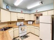 Beach themed kitchen - Condo for sale at 211 Rubens Dr #h, Nokomis, FL 34275 - MLS Number is N6103629