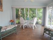 BEAUTIFUL FLORIDA ROOM, ALL SEASONS! PRETTY AND PRIVATE VIEW! - Villa for sale at 572 Clubside Cir #34, Venice, FL 34293 - MLS Number is N6105221