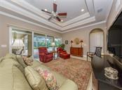 Family room with sliders to lanai/pool - Single Family Home for sale at 189 Portofino Dr, North Venice, FL 34275 - MLS Number is N6106071
